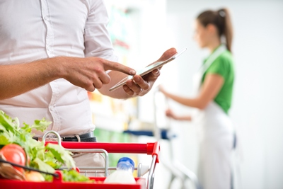 Customer with tablet at supermarket