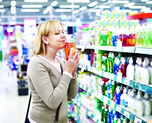 woman-smelling-fragrant-liquid-soap-store-51393510